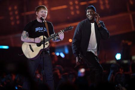 FILE PHOTO:  Ed Sheeran and Stormzy perform at the Brit Awards at the O2 Arena in London, Britain, February 22, 2017.  REUTERS/Toby Melville/File Photo