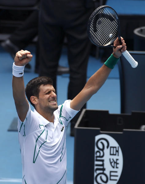 Serbia's Novak Djokovic celebrates after defeating Diego Schwartzman of Argentina in their fourth round singles match at the Australian Open tennis championship in Melbourne, Australia, Sunday, Jan. 26, 2020. (AP Photo/Andy Wong)