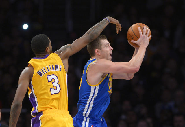 Golden State Warriors forward David Lee, right, goes up for a shot as Los Angeles Lakers forward Shawne Williams defends during the first half of an NBA basketball game, Friday, Nov. 22, 2013, in Los Angeles. (AP Photo/Mark J. Terrill)
