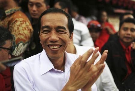 Jakarta governor and presidential candidate Widodo reacts during a campaign in Jakarta