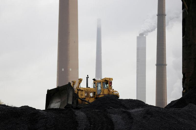 FILE PHOTO: A bulldozer moves coal at the Murray Energy Corporation port facility in Powhatan Point, Ohio, U.S., November 7, 2017. REUTERS/Joshua Roberts/File Photo