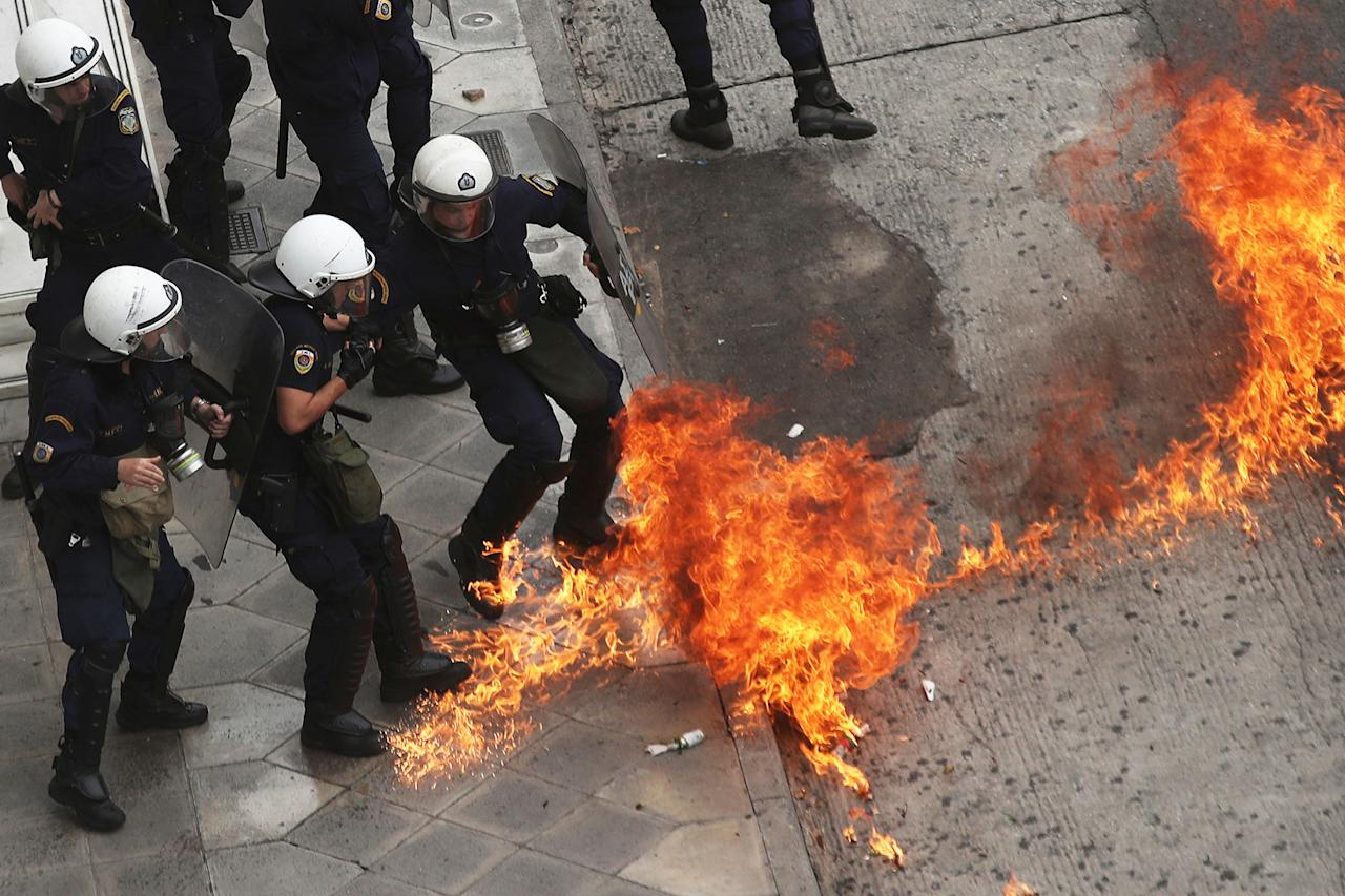<p>Riot police officers try to avoid a patrol bomb thrown by protester during a nationwide general strike demonstration. in Athens Wednesday, May 17, 2017. Greek workers walked off the job across the country Wednesday for an anti-austerity general strike that was disrupting public and private sector services across the country. (AP Photo/Petros Giannakouris) </p>