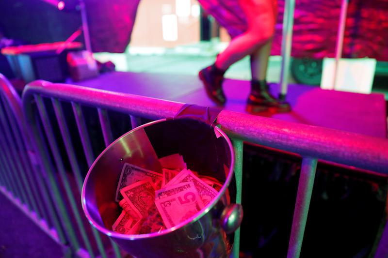 Tips are seen in a drive-through go-go dance tent offered by the Lucky Devil Lounge strip club in the wake of the coronavirus disease (COVID-19) restrictions in Portland, Oregon, U.S. April 24, 2020. Picture taken April 24, 2020. REUTERS/Terray Sylvester