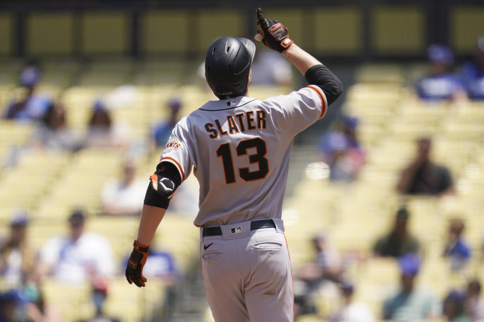 San Francisco Giants' Austin Slater (13) celebrates after hitting a home run during the third inning of a baseball game against the Los Angeles Dodgers Sunday, May 30, 2021, in Los Angeles. (AP Photo/Ashley Landis)