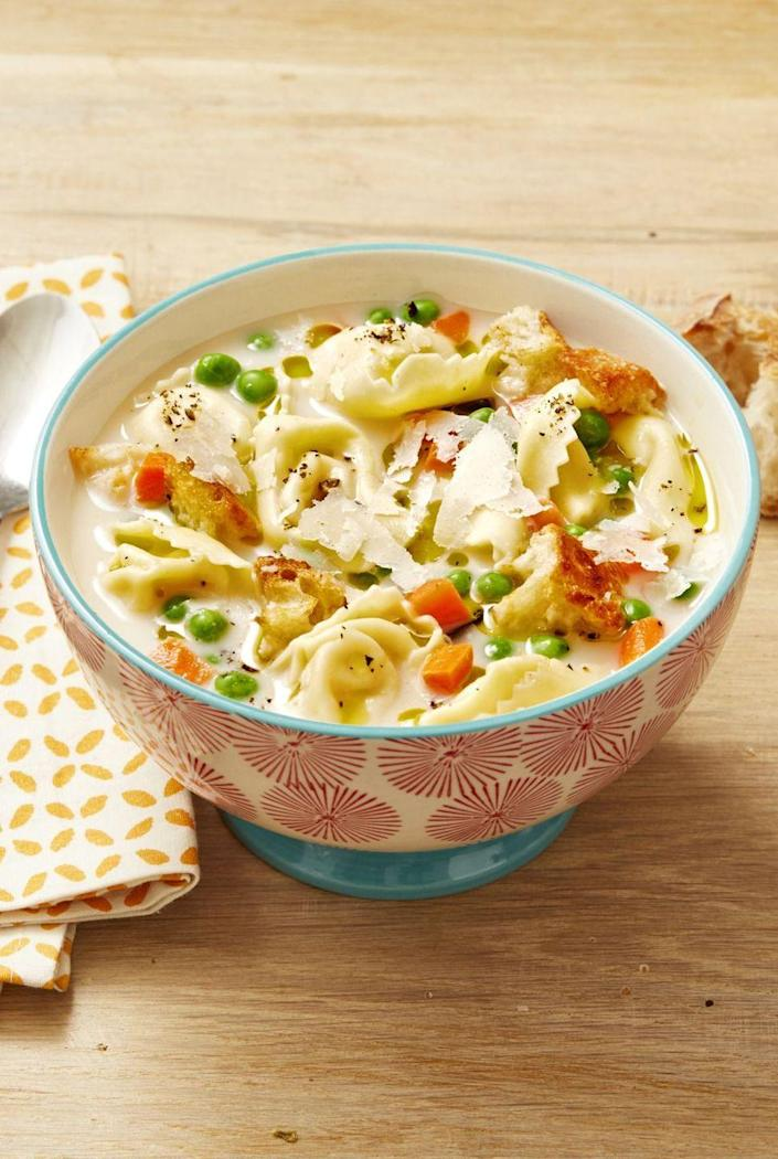 """<p>This cheesy tortellini soup will hit the spot on a rainy day. Plus, it comes together in just 15 minutes!</p><p><strong><a href=""""https://www.thepioneerwoman.com/food-cooking/recipes/a32494718/creamy-tortellini-soup-recipe-idea/"""" rel=""""nofollow noopener"""" target=""""_blank"""" data-ylk=""""slk:Get the recipe."""" class=""""link rapid-noclick-resp"""">Get the recipe.</a></strong> </p>"""