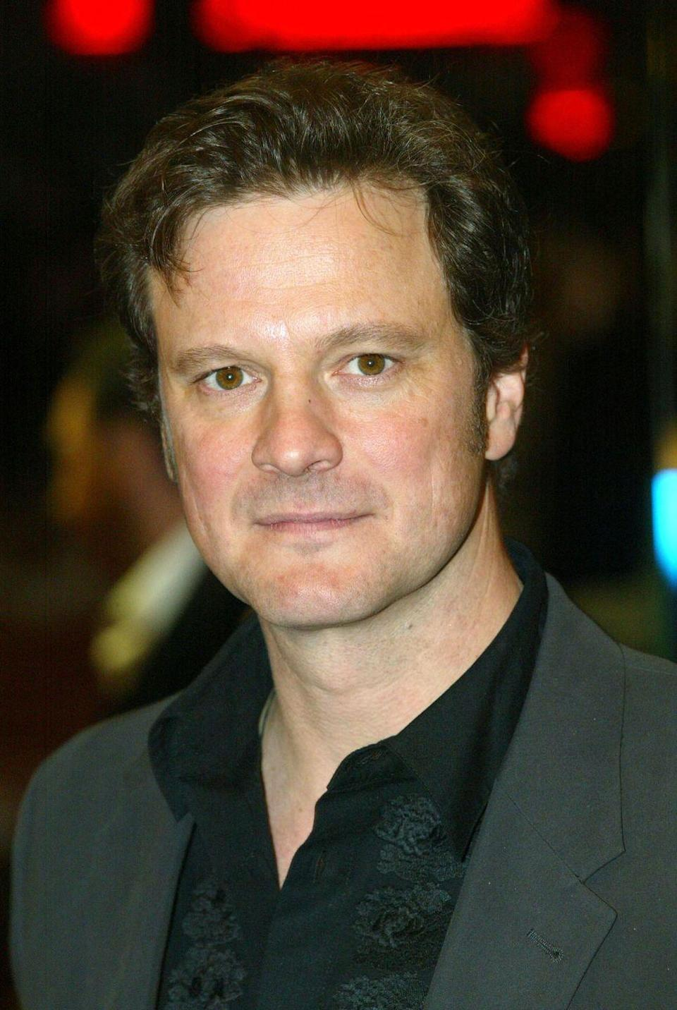 <p>From <em>Pride & Prejudice </em>to <em>Bridget Jones's Diary</em>, Colin Firth's curly brown hair is part of his signature look.</p>
