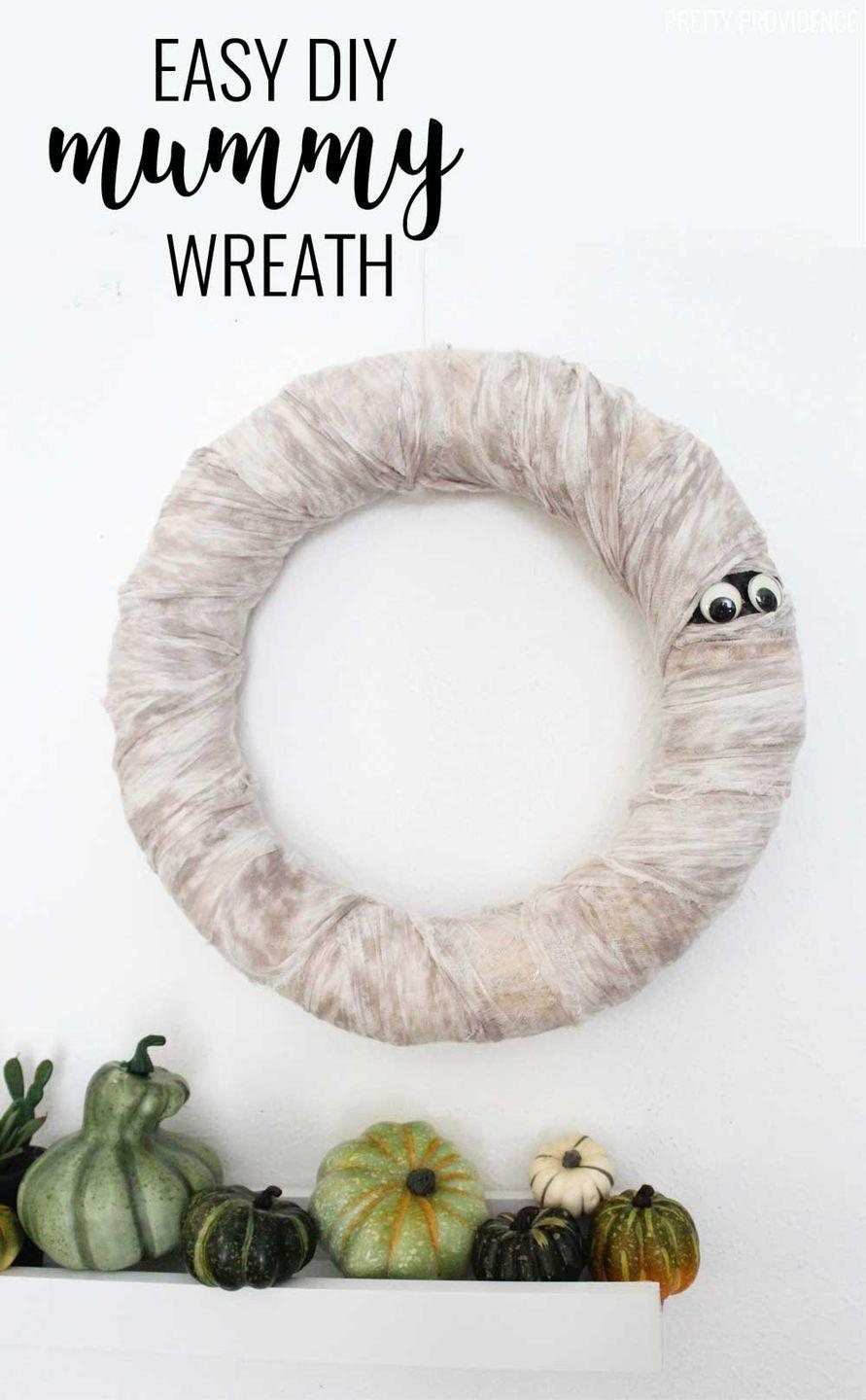 """<p>This monochromatic mummy <a href=""""https://www.goodhousekeeping.com/holidays/halloween-ideas/g79/diy-halloween-wreaths/"""" rel=""""nofollow noopener"""" target=""""_blank"""" data-ylk=""""slk:wreath"""" class=""""link rapid-noclick-resp"""">wreath</a> will pop against any front door color, especially black and red. Spot the googly eyes! </p><p><em><a href=""""https://prettyprovidence.com/halloween-mummy-wreath/"""" rel=""""nofollow noopener"""" target=""""_blank"""" data-ylk=""""slk:Get the tutorial at Pretty Providence »"""" class=""""link rapid-noclick-resp"""">Get the tutorial at Pretty Providence »</a></em> </p>"""