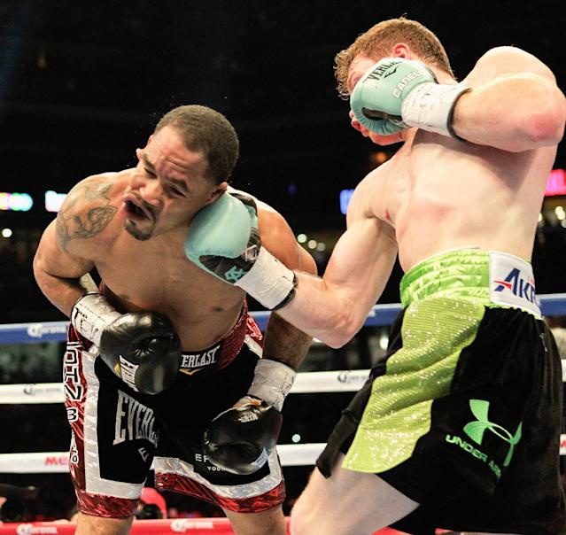 "Saul ""Canelo"" Alvarez, right, lands an uppercut to the jaw of James Kirkland during their 154-pound fight on Saturday, May 9, 2015, in Houston. Alvarez won the bout. (AP Photo/Bob Levey)"