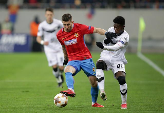 Soccer Football - Europa League - Steaua Bucharest vs FC Lugano - National Arena, Bucharest, Romania - December 7, 2017 Steaua Bucharest's Ovidiu Popescu in action with Lugano's Guy Eloge Koffi Yao REUTERS/Octav Ganea