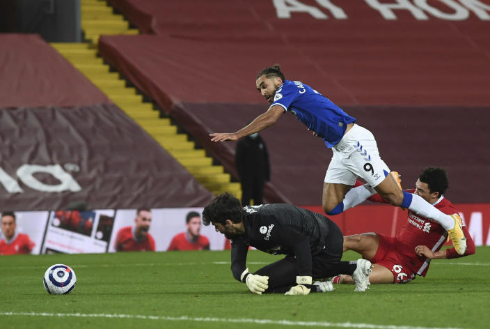 Liverpool's Trent Alexander-Arnold, (66) right, fouls Everton's Dominic Calvert-Lewin, for a penalty from which Everton's Gylfi Sigurdsson scored his sides second goal of the game during the English Premier League soccer match between Liverpool and Everton at Anfield in Liverpool, England, Saturday, Feb. 20, 2021. (Phil Noble/ Pool via AP)(Lawrence Griffiths/ Pool via AP)