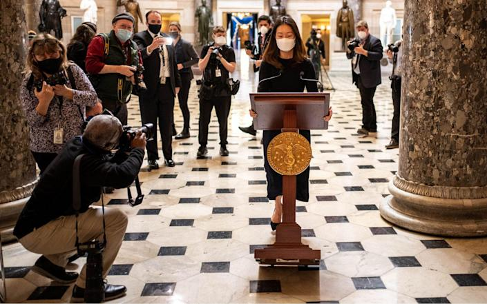 A staff member for House Nancy Pelos wheels her podium through Statutory Hall at the U.S. Capitol. This is the same podium that was taken out of Pelosi's office by pro-Trump MAGA mobs - Ken Cedeno/UPI/Shutterstock/Shutterstock