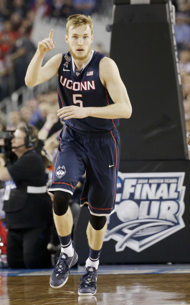 Connecticut guard/forward Niels Giffey (5) gestures as he moves down the floor against Florida during the second half of the NCAA Final Four tournament college basketball semifinal game Saturday, April 5, 2014, in Arlington, Texas. Connecticut won 63-53. (AP Photo/David J. Phillip)