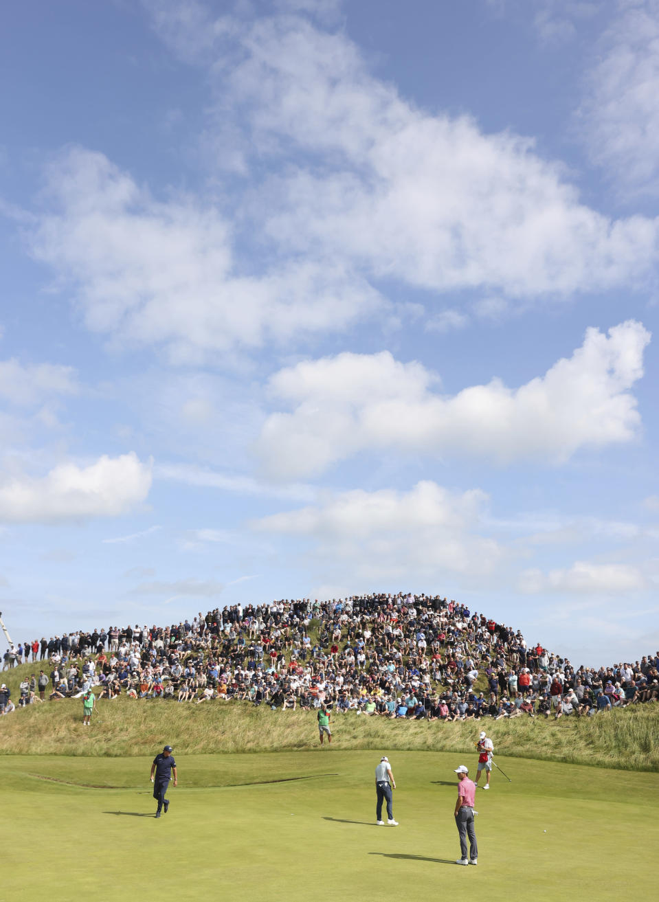 United States' Phil Mickelson, left, England's Terrell Hatton, and United States' Kevin Kisner walk on the 6th green prior to putting during the first round British Open Golf Championship at Royal St George's golf course Sandwich, England, Thursday, July 15, 2021. (AP Photo/Ian Walton)