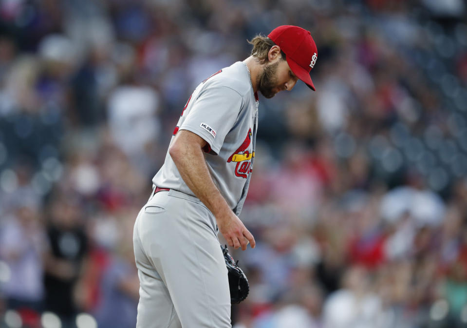 St. Louis Cardinals starting pitcher Michael Wacha looks down after giving up a two-run home run to Colorado Rockies' Nolan Arenado during the first inning of a baseball game Tuesday, Sept. 10, 2019, in Denver. (AP Photo/David Zalubowski)