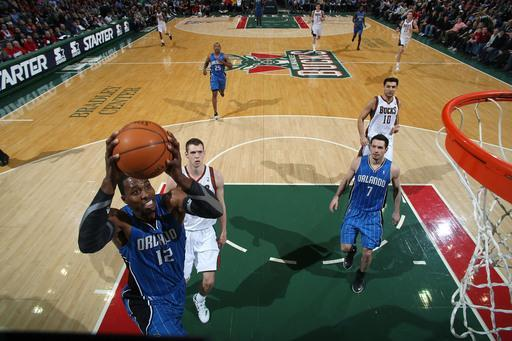 MILWAUKEE, WI - FEBRUARY 20: Dwight Howard #12 of the Orlando Magic goes to the basket against Jon Leuer #30 of the Milwaukee Bucks during the game on February 20, 2012 at the Bradley Center in Milwaukee, Wisconsin. (Photo by Gary Dineen/NBAE via Getty Images)