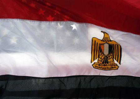 American flag is seen behind Egyptian flag at a rally against Egypt's President Mubarak in Westwood