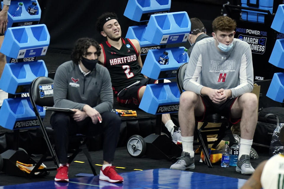 Hartford's D.J. Mitchell (2) is treated on the bench after being injured during the first half of a college basketball game against Baylor in the first round of the NCAA tournament at Lucas Oil Stadium in Indianapolis Friday, March 19, 2021, in Indianapolis, Tenn. (AP Photo/Mark Humphrey)