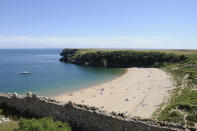 Another National Trust beach, the intimate Lundy Bay is home to a collapsed sea-cave where visitors can enjoy rock pooling at low tide. At high tide, enjoy the clifftop views above where you can bask in the beauty of the surrounding Polzeath. [Photo: Getty]