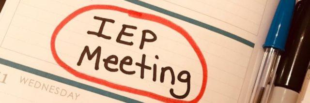 "Planner with words ""IEP meeting"" circled"