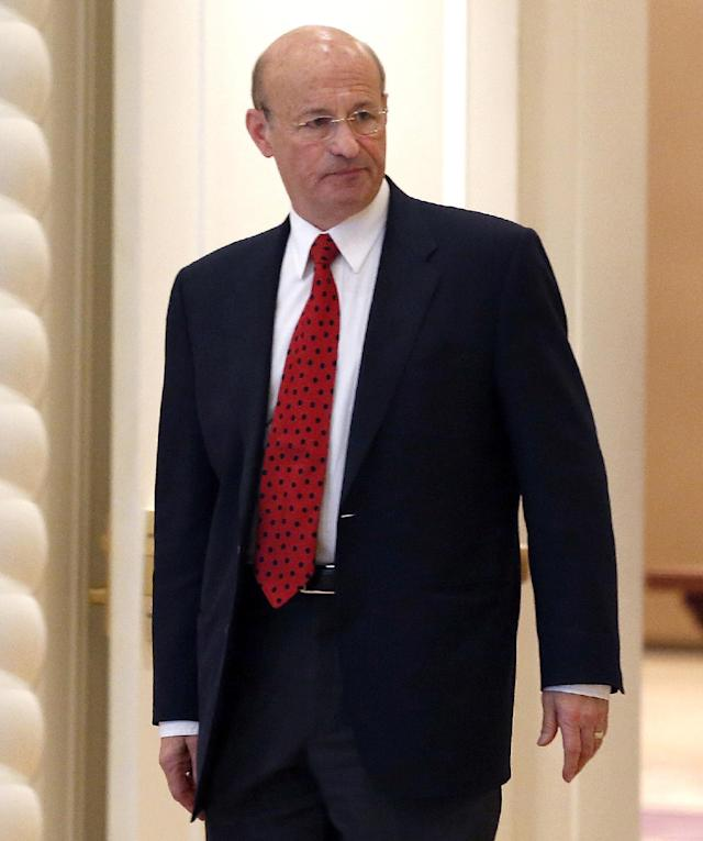 Los Angeles Dodgers president Stan Kasten heads for morning meetings at baseball's general managers' meetings Thursday, Nov. 14, 2013, in Orlando, Fla. (AP Photo/Reinhold Matay)