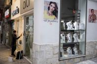 First day of the re-opening of retail stores, amid the coronavirus disease (COVID-19) pandemic, in Athens