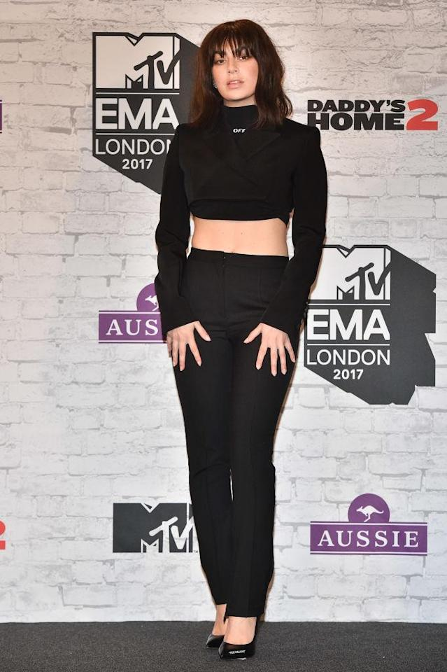 <p>Charli XCX wore a crop to turtleneck with tailored trousers for the event. (Photo: Getty Images) </p>