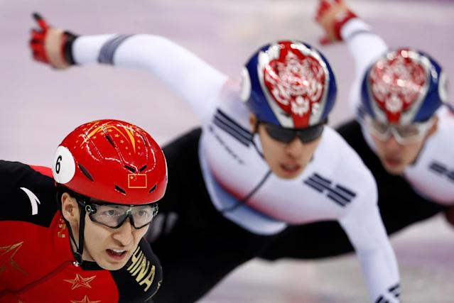 "Short Track Speed Skating Events - Pyeongchang 2018 Winter Olympics - Men's 500m Final - Gangneung Ice Arena - Gangneung, South Korea - February 22, 2018 - Wu Dajing of China, Hwang Dae-heon of South Korea and Lim Hyo-jun of South Korea compete. REUTERS/Damir Sagolj SEARCH ""OLYMPICS BEST"" FOR ALL PICTURES. TPX IMAGES OF THE DAY."