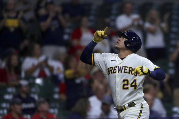 Milwaukee Brewers' Avisail Garcia gestures after hitting a solo home run during the second inning of a baseball game against the St. Louis Cardinals, Monday, Sept. 20, 2021, in Milwaukee. (AP Photo/Aaron Gash)