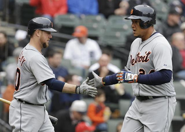Detroit Tigers' Miguel Cabrera, right, celebrates with Bryan Holaday after scoring on a sacrifice fly hit by Nick Castellanos during the fourth inning of a baseball game against the Chicago White Sox in Chicago on Wednesday, April 30, 2014. (AP Photo/Nam Y. Huh)