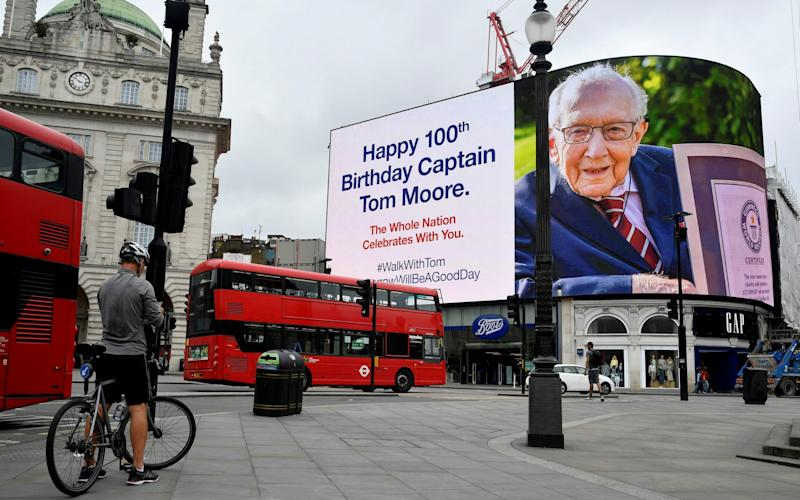A happy birthday message is displayed on the big screen in Piccadilly Circus for army veteran Captain Tom Moore on his 100th birthday, following the outbreak of the coronavirus disease (COVID-19), in London, Britain, April 30, 2020. REUTERS/Toby Melville/File Photo - Toby Melville/Reuters