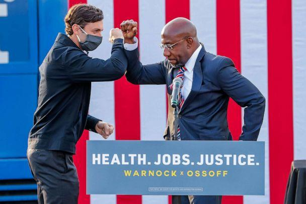 PHOTO: Senate candidates Jon Ossoff and Reverend Raphael Warnock participate in a dual campaign event during the final week of early voting in their US Senate runoff election in Stonecrest, Ga., Dec. 28, 2020. (Erik S. Lesser/EPA via Shutterstock)