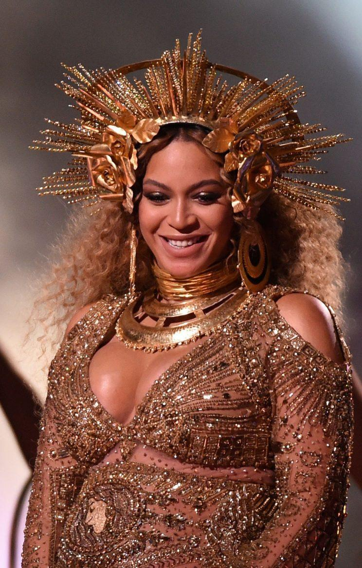 <i>Beyonce transformed into a golden goddess at the 2017 Grammys [Photo: Rex]</i>