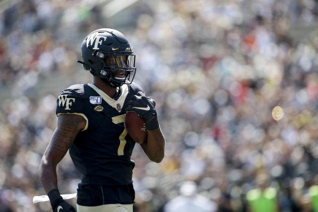 Wake Forest wide receiver Scotty Washington scores a touchdown against Elon in the first half of an NCAA college football game in Winston-Salem, N.C., Saturday, Sept. 21, 2019. (AP Photo/Nell Redmond)