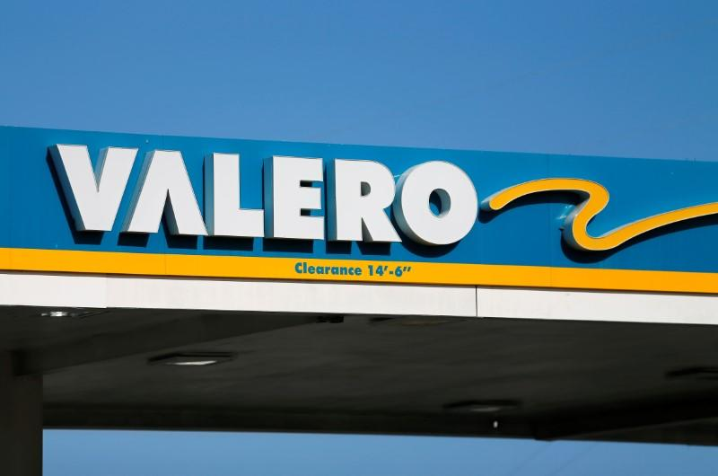 A Valero gas station sign is shown in Encinitas, California