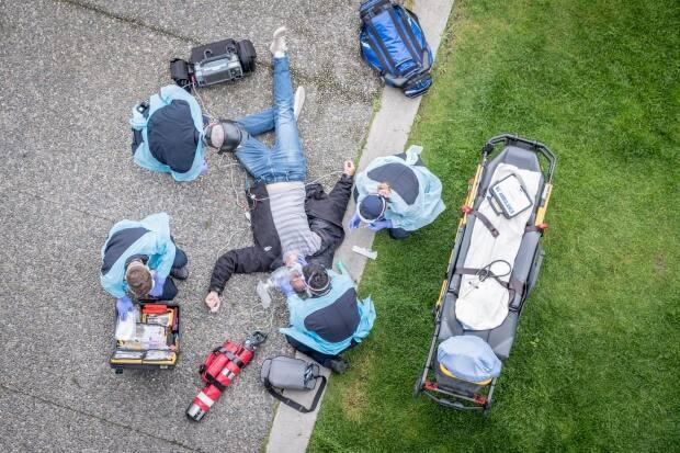 B.C. paramedics in full protective gear practise an emergency response to a drug overdose.