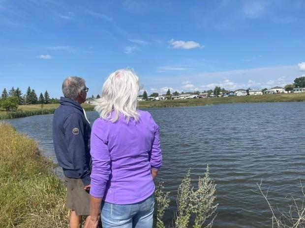 Ken, left, and Gwelda Hales, right, helped look for the five-year-old boy who was later pulled from Wascana Creek on Thursday afternoon.  (Janani Whitfield/CBC - image credit)