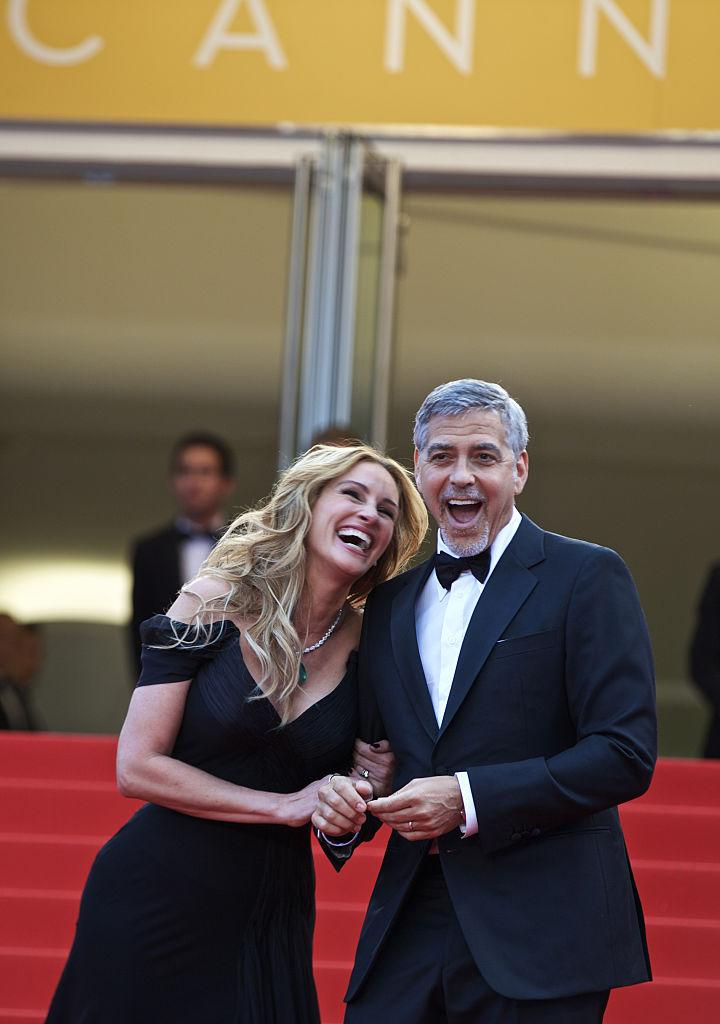 George Clooney makes Julia Roberts smile at the Cannes Film Festival in 2016. (Photo: Xinhua/Jin Yu)