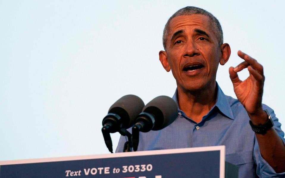 Barack Obama addresses Biden-Harris supporters during a drive-in rally in Philadelphia, Pennsylvania - AFP