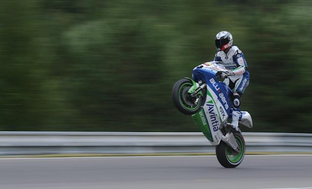 Moto GP rider Yonny Hernandez of Colombia wheeles during the free practice session ahead of tomorrow's Czech Republic MotoGP category on August 25, 2012 in Brno. AFP PHOTO/ MICHAL CIZEKMICHAL CIZEK/AFP/GettyImages