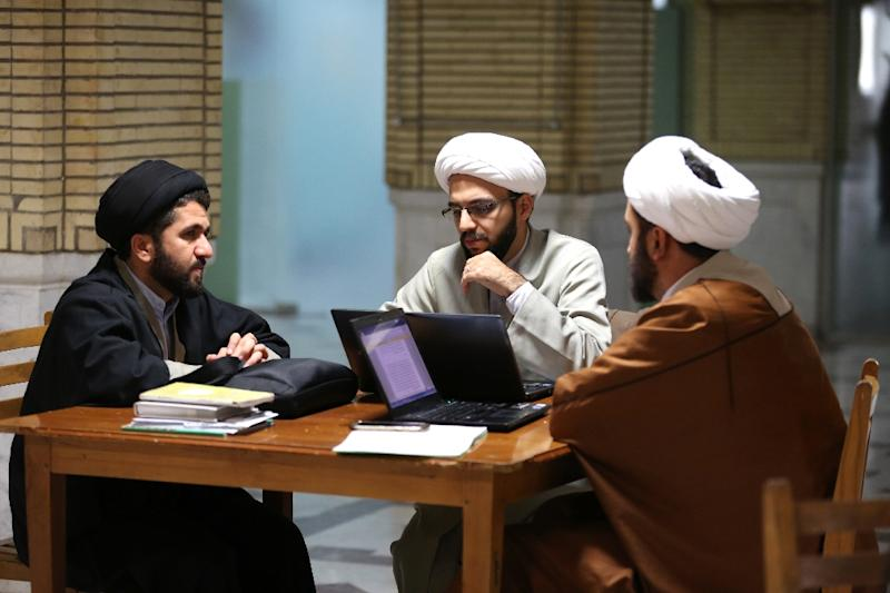 Shiite Muslim clerics study at the Imam Khomeini Education and Research Institute in the holy city of Qom, south of Tehran (AFP Photo/ATTA KENARE)