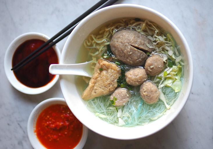 The 'bakso' is served with two types of noodles, bouncy meatballs and a stuffed beancurd puff