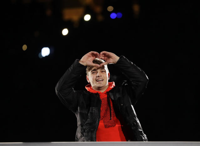 <p>DJ Martin Garrix from the Netherlands gestures during the closing ceremony of the 2018 Winter Olympics in Pyeongchang, South Korea, Sunday, Feb. 25, 2018. (AP Photo/Kirsty Wigglesworth) </p>