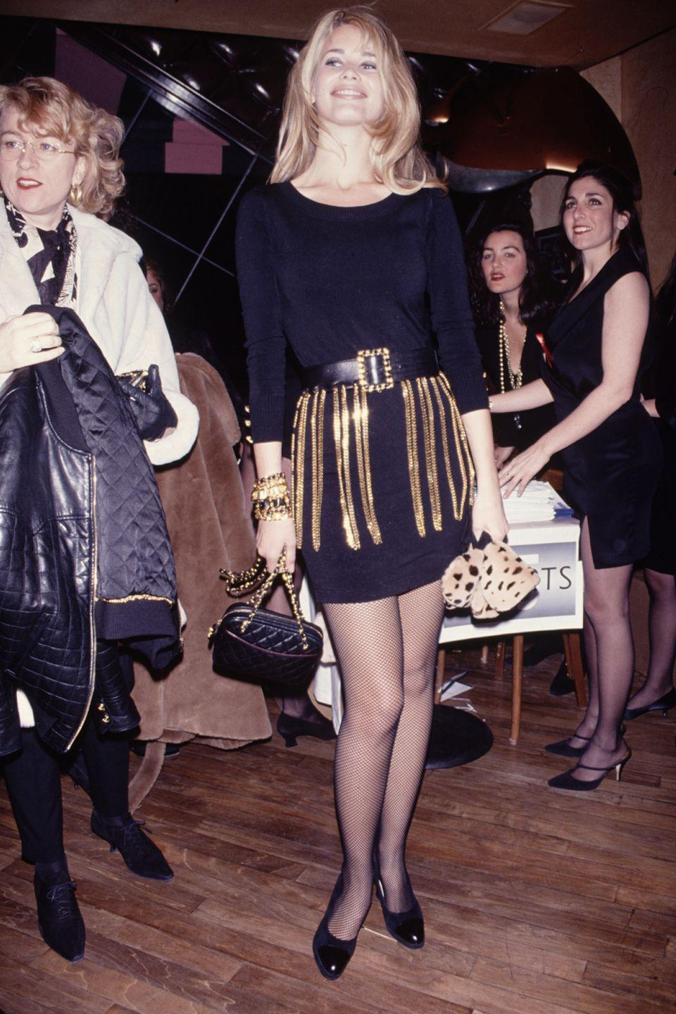 <p>All about the accessories! I'm wearing classic Chanel little black dress with an incredible Chanel gold buckled chain belt complete with matching gold cuff bracelet and gold chained shoulder bag</p>