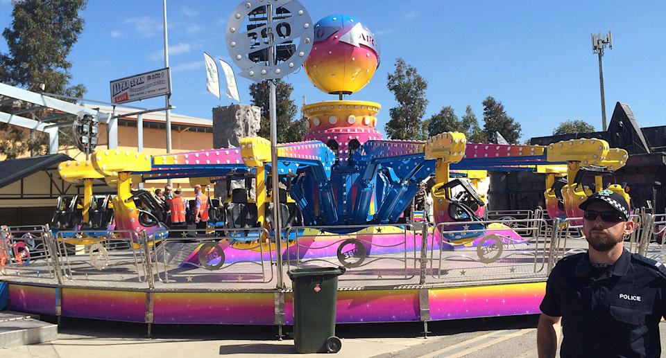 Police guard the Airmaxx 360 ride where an eight-year-old girl fell to her death.