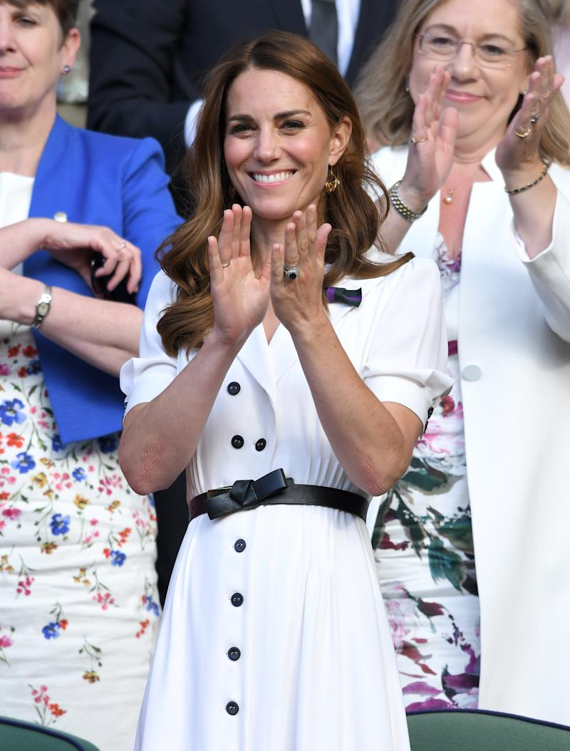 Kate Middleton, Duchess of Cambridge claps as she attends day 2 of the Wimbledon Tennis Championships at the All England Lawn Tennis and Croquet Club on July 02, 2019