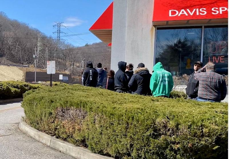 Shoppers await entry into outdoor gear, gun and ammunition retailer Davis Sport Shop in Sloatsburg, New York Saturday, March 21, 2020.
