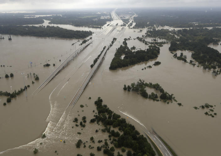 <p>Interstate 69 is covered by floodwaters from Tropical Storm Harvey Tuesday, Aug. 29, 2017, in Humble, Texas. (Photo: David J. Phillip/AP) </p>