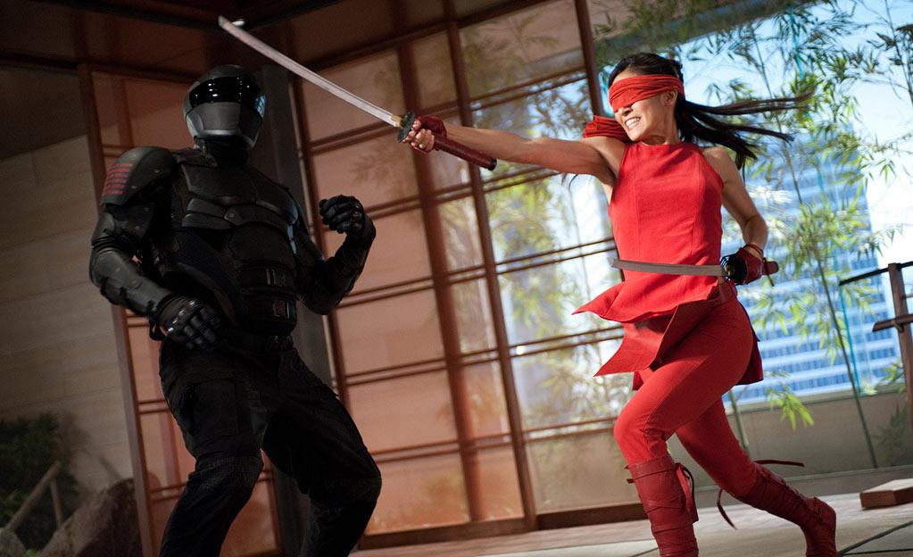 """<b>COBRA Ninjas</b><br> Elodie Yung plays the super secret code-named Jinx in """"G.I. Joe Retaliation,"""" in theaters June 29. At one point in the film, she and Snake Eyes (played by Ray Park) battle a throng of Cobra ninjas on the side of a mountain. Director John Chu <a>recently divulged</a> that he kept in a 10-whole-minute fighting sequence that contains absolutely no dialogue. Whoa! Talk about indulgent!"""