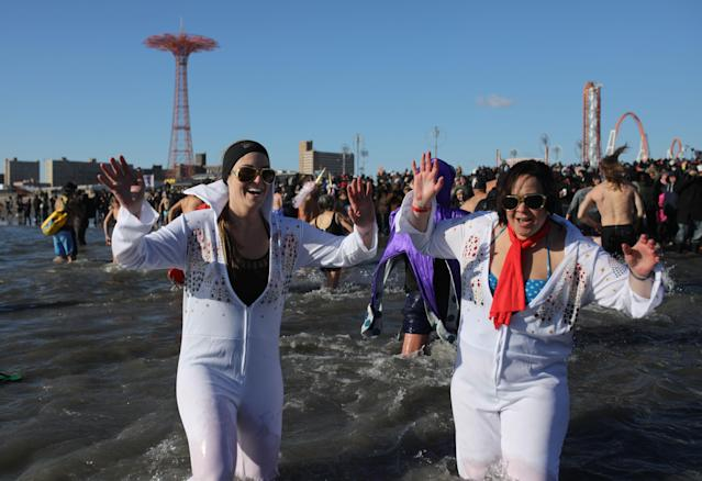 <p>Participants are seen in the water during a polar bear plunge at the beach in Coney Island, Brooklyn on Jan. 1, 2018. New Yorkers took part in new year's day swim with temperature standing at -7 degrees Celsius. (Photo: Atilgan Ozdil/Anadolu Agency/Getty Images) </p>