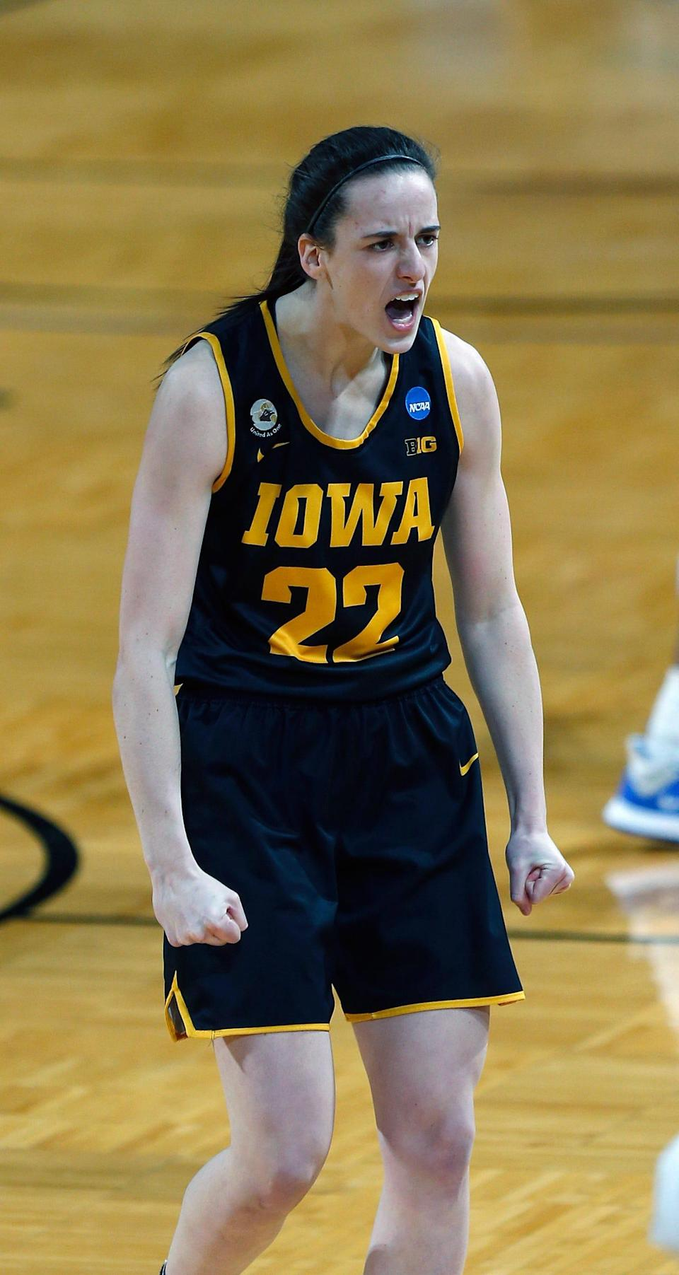 Iowa guard Caitlin Clark reacts after hitting a three-pointer during the first half against Kentucky.